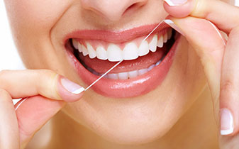 Smile while flossing